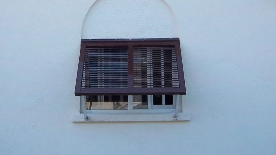 Brown Shutters over window
