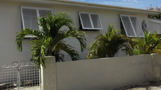 Three Bahama Shutters on Residential Home