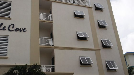 Commercial application of Bahama Shutters on Hotel